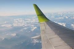 Tema di viaggio æreo di un'ala dell'aeroplano Immagine Stock Libera da Diritti