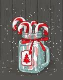 Tema do Natal, bastões de doces no frasco de vidro com fita vermelha, ilustração Foto de Stock