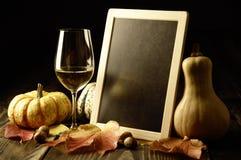 Abóboras, vinho branco e folhas de outono Imagens de Stock Royalty Free