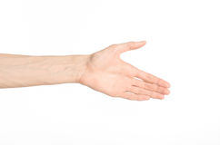 Tema dos gestos de mão: a mão humana mostra gestos isolada no fundo branco no estúdio Fotografia de Stock