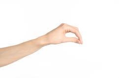 Tema dos gestos de mão: a mão humana mostra gestos isolada no fundo branco no estúdio Imagens de Stock