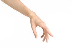 Tema dos gestos de mão: a mão humana mostra gestos isolada no fundo branco no estúdio Foto de Stock