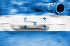 Tema för militär styrka, behållare för rörelsesuddighet med den Honduras flaggan Arkivfoto
