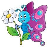 Tema felice 1 del fiore della tenuta della farfalla Fotografia Stock