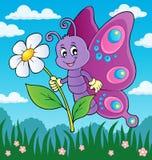 Tema felice 3 del fiore della tenuta della farfalla Immagine Stock