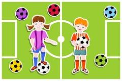 tema för fotboll för pojkefotbollflicka Fotografering för Bildbyråer