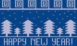 Tema hecho punto del Año Nuevo con nieve del amd de los abetos en azul Foto de archivo