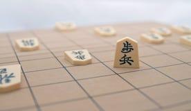 Tema japonés del conjunto de ajedrez (Shogi): Victoria Foto de archivo libre de regalías