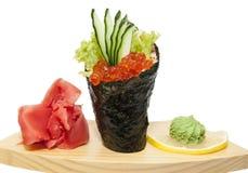 Temaki. Japanese cuisine in the restaurant Temaki with salmon caviar Stock Photo