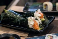 Temaki sushi roll with fresh salmon, avocado and philadelphia cheese Stock Photography