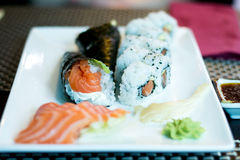 Temaki sushi, sushi, salmon and wasabi on a plate Stock Image