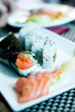 Temaki sushi, sushi, salmon and wasabi on a plate Royalty Free Stock Photos