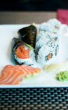 Temaki sushi, sushi, salmon and wasabi on a plate Royalty Free Stock Image