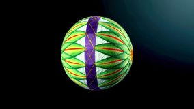 Temari球,在传统日本风格的一个工艺品球在黑暗的backgroung 免版税库存图片