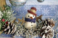 Temas de la Navidad de la postal del muñeco de nieve Imagen de archivo