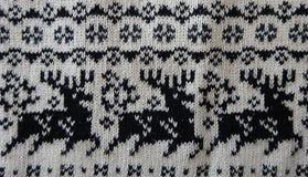 Temas de los ciervos de la Navidad de la tela de materia textil de las lanas que hacen punto foto de archivo libre de regalías