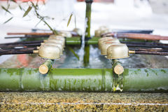Temizuya :: water ablution pavilion for a purify the soul. In Japanese Shrine Stock Photography