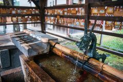 Temizuya :: water ablution pavilion for a purify the soul. In Japanese Shrine Stock Photos