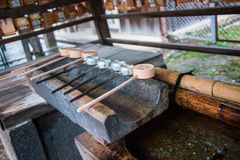 Temizuya :: water ablution pavilion for a purify the soul. In Japanese Shrine Stock Image