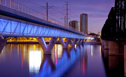 Tempe Arizona Light Rail Bridge and City. Phoenix Metro light rail bridge across the Salt River in Tempe Arizona photographed at sunset royalty free stock images