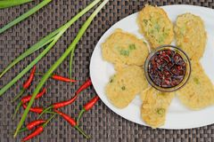 Tempe mendoan, Indonesian cuisine. Tempe mendoan, battered fried sliced tempeh served with red chili and soy sauce Royalty Free Stock Photos