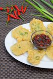 Tempe Mendoan, Indonesian food. Battered sliced fried Tempeh served with chili soy sauce Stock Photo
