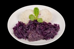 Tempeh with red cabbage and sorghum on a black. Background stock images