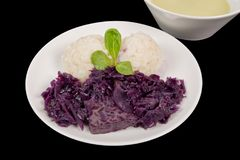 Tempeh with red cabbage and sorghum on a black. Background royalty free stock image