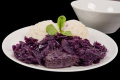 Tempeh with red cabbage and sorghum on a black. Background royalty free stock images
