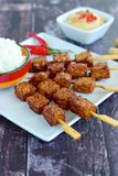 Tempeh satay with peanut sauce. Tempeh skewers / Tempe satay with peanut sauce and rice, Indonesian cuisine Stock Images