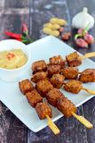 Tempeh skewers with peanut sauce. Tempeh skewers / Tempe satay with peanut sauce, Indonesian food Royalty Free Stock Photo