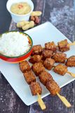 Tempeh skewers with peanut sauce. Tempeh skewers / Tempe satay with peanut sauce, Indonesian food Royalty Free Stock Photography