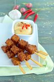 Tempeh skewers with peanut sauce. Tempeh skewers / Tempe satay with peanut sauce, Indonesian food Stock Photo