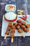 Tempeh skewers with peanut sauce. Tempeh skewers / Tempe satay with peanut sauce and rice, Indonesian food Stock Photo