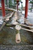 tempel för springbrunnpurificationryoanji royaltyfria bilder