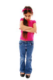 Temper tantrum. Moody unhappy looking girl with arms folded isolated on white Royalty Free Stock Images