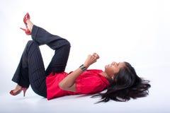 Temper Tantrum. Indian woman lying on floor throwing a tantrum royalty free stock photo