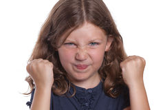 Temper Tantrum Girl. A cute little girl clenches her fists in frustration while having a tantrum Stock Photo