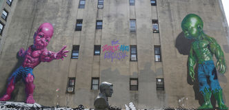 Temper Tot murals by Ron English in Little Italy in Manhattan. NEW YORK - AUGUST 8, 2015:Temper Tot murals by Ron English in Little Italy in Manhattan. A mural Stock Image