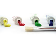 Tempera tubes with brush. On white Stock Images