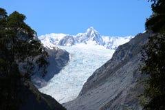 Fox Glacier, Te Moeka o Tuawe, New Zealand. The temperate maritime Fox Glacier, Te Moeka o Tuawe, in Westland Tai Poutini National Park on the West Coast of stock images