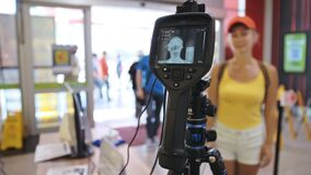 Temperature check at a supermarket, grocery store with a thermal imaging camera installed. Image monitoring scanner to