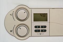 Temperature control dial for central heating at home Stock Photo