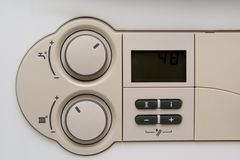 Temperature control dial for central heating at home Royalty Free Stock Photography
