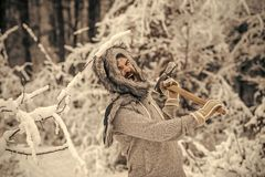 Temperature, freezing, cold snap, snowfall. Skincare and beard care in winter, beard warm in winter. Man lumberjack with ax. Camping, traveling and winter rest royalty free stock image
