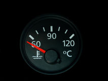 Temperature gauge. Temperature  gauge with a red needle  on car a dashboard isolated on black Royalty Free Stock Photography