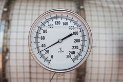 Temperature gauge of gas booster compressor. Stock Photos