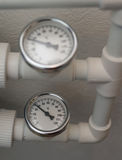 Temperature gauge mounted on the heating pipes.  Stock Photography