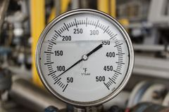Temperature gauge oil and gas operation. Temperature gauge reading in falenhine in offshore oil and gas opration Royalty Free Stock Photo