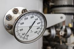 Temperature gauge reading in falenhine in offshore oil and gas o. Pration Stock Photos